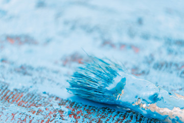 Painting with blue paint of an old wooden background