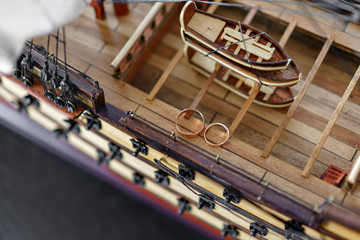 Wedding Rings on Wood model of the medieval ship. Bride and groom accessories. Maritime concept