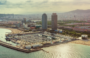 Barcelona aerial,  Port Olimpic with boats and city skyline, Spain. Vintage colors