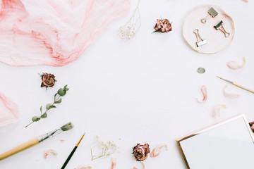 Frame with empty space, photo frame, pink blanket, eucalyptus branches and rose flowers on white background. Flat lay, top view still life artist blog hero header. Wedding concept.