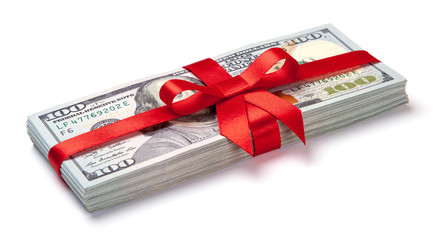 Concept, money as gift, win or bonus. Pile of 100 dollar bills is tied with red ribbon with bow. Isolated on white background.