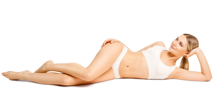 Body Beauty, Sexy Woman in Cotton Underwear Lying Down on Side, Slim Girl Isolated over White Background