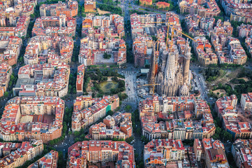 Barcelona aerial view, Eixample residencial district and Sagrada familia, Spain. Typical urban grid