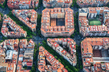 Aerial view of Barcelona buildings, high angle view of the city typical urban grid, Spain