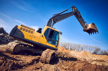 excavator loader machine earthmoving soil at construction site