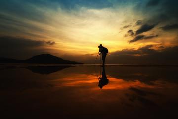 Landscape Photographer silhouette reflection on beach