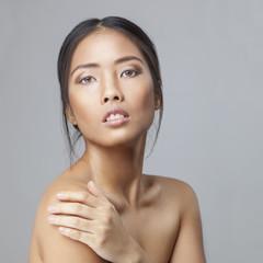 Asian beauty skincare woman touching skin on shoulder