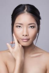 Asian beauty skincare woman touching skin on face