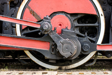 Chassis of the old train. Steel heavy wheels of a steam locomotive.