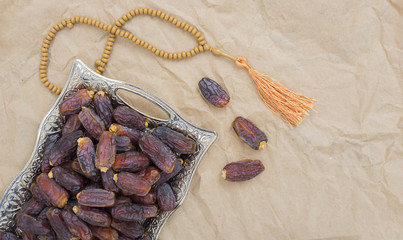 date palm fruit with prayer beads