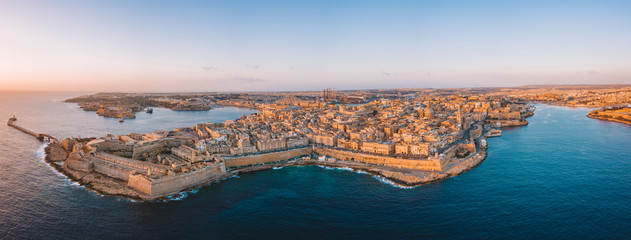 Fotomurales - Aerial view over Spinola Bay with Traditional maltese Luzzu fishing boats