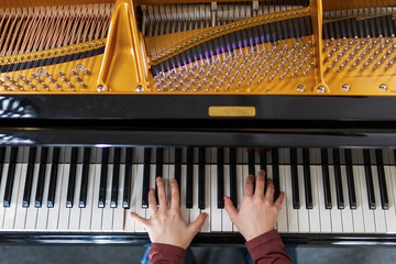Woman's hand playing piano.