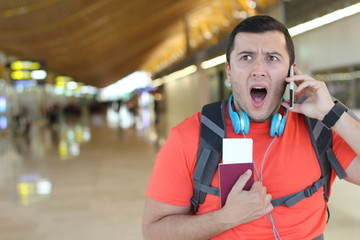 Scared man getting a call at the airport
