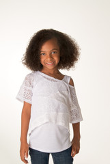 Smiling happy little girl isolated against white