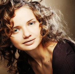 beautiful young woman with curly hair