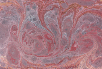 Marble abstract acrylic background. Pink and blue marbling artwork texture. Agate ripple pattern. Gold powder.