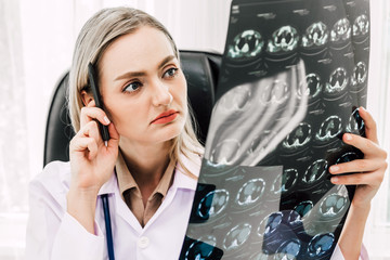 Female doctor looking at x-ray photo in hospital.healthcare and medicine