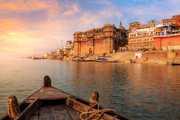 Varanasi ancient city architecture at sunset as viewed from a boat on river Ganges. Wall mural
