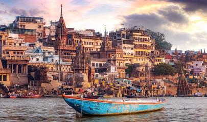 Varanasi city with ancient architecture. View of the holy Manikarnika ghat at Varanasi India at sunset. Wall mural