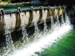 City concrete dam on Bosna river in Sarajevo on a lovely summer day