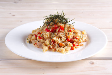 Pilaf with fish, pepper and seaweed