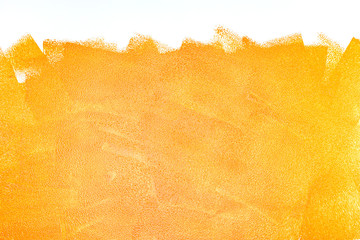 orange acrylic paint roller strokes texture on white wall