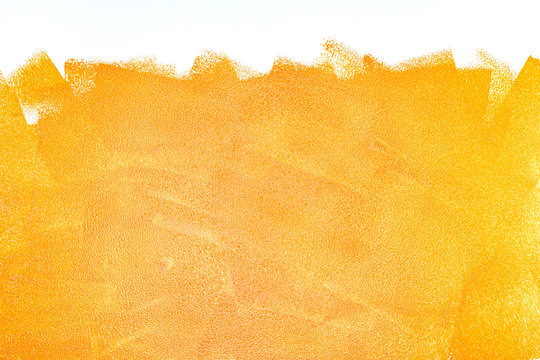 orange acrylic paint roller strokes texture on white wall