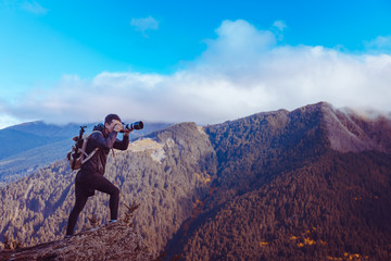 A Photographer taking photo of Queenstown mountain, New Zealand