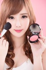 woman take makeup brush