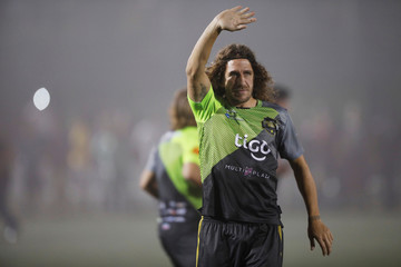 Former Spanish soccer player Carles Puyol waves to the publc as he warms up prior to an exhibition match at Las Delicias Stadium in Santa Tecla, El Salvador
