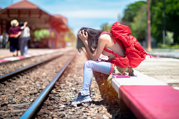 young woman lost and missing train departure earlier than expect, late trip in worry, upset travelling, disappoint in late comming CONCEPT