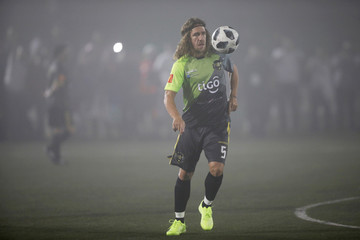 Former spanish soccer player Carles Puyol warms up prior to an exhibition match at Las Delicias Stadium in Santa Tecla