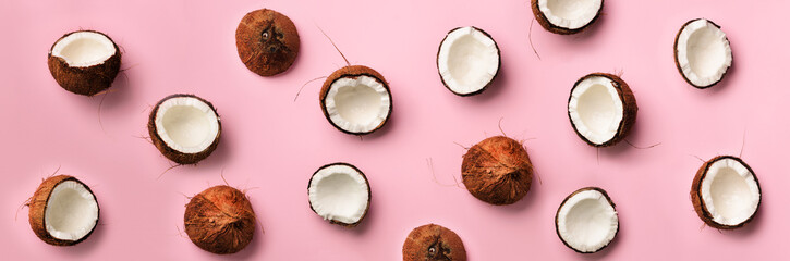 Pattern with ripe coconuts on pink background. Top View. Copy Space. Pop art design, creative summer concept. Half of coconut in minimal flat lay style. Wall mural