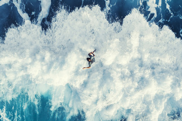 Surfer on the big wave, top view