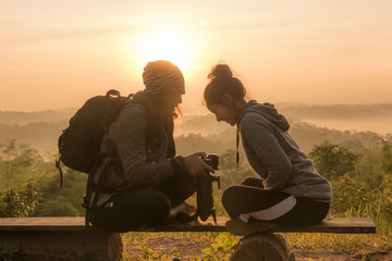 Two friends are looking at the camera. Sunrise photo