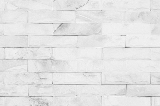 grey colors and white brick wall art concrete stone texture background in wallpaper limestone abstract paint to flooring and homework/Brickwork or stonework clean grid uneven interior rock old.