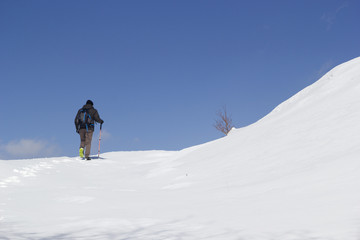 hikers walking in the snow in mountain