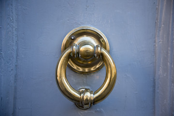 Decorative metal ring knock door, in Italy most homes have doors with these handles.