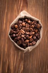 Fresh roasted coffee beans in burlap sack