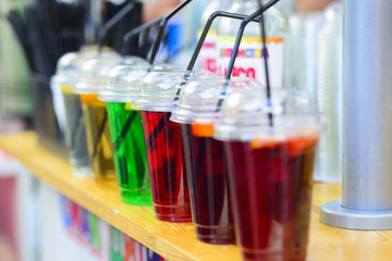 Cups with sparkling fresh natural fruit lemonades