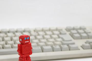 ロボットとパソコンのキーボード 人工知能イメージ
