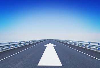 Straight motorway with a forward arrow. Concept of moving ahead