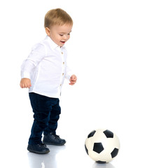 Little boy is playing with a soccer ball.