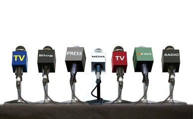 Press interview microphones on a table over white