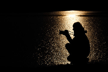Silhouette of a photographer at sunset