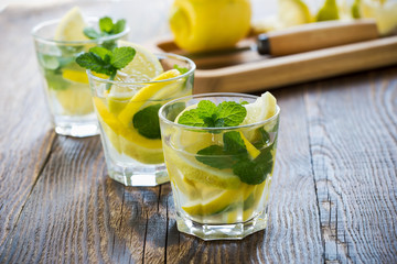 Fresh homemade lemonade with lemon and mint