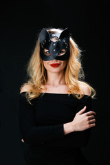 Photo of blonde in mask with arms crossed at waist
