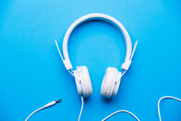 Image of white headphones on blue background