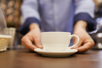 Image of barist man with cup of coffee