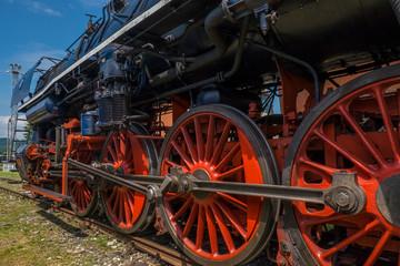 Steam locomotive with red wheels